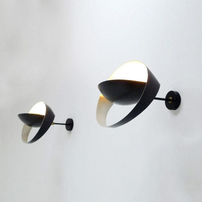 Pair of «Grand Saturne» wall lamps